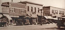 The view from this historic Newberry, MI photo was taken in the 1930s.  The photographer captured this beautiful image looking north west downtown Newberry.